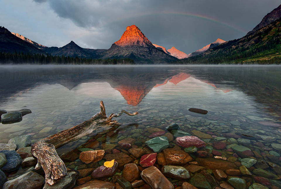 """""""Morning Beacon""""   Sinopah mountain emerging from a sunrise storm reflected by 2 Medicine Lake at Glacier National Park."""