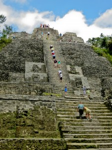 Tourists climbing the High Temple at Lamani Belize